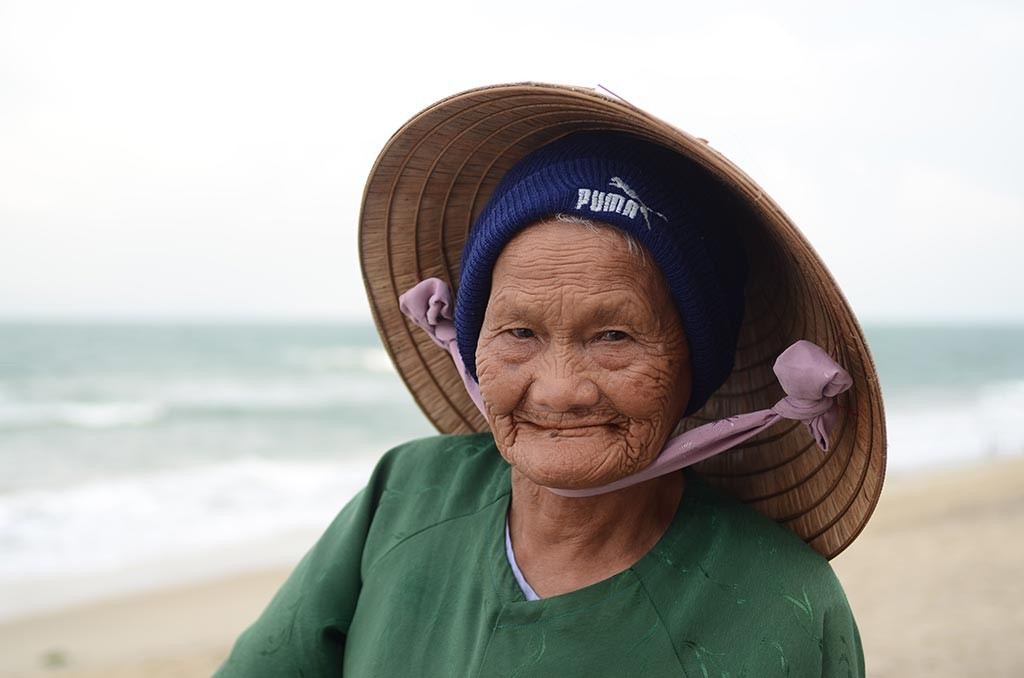 this is an old woman in hoi an beach