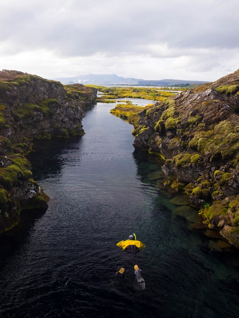 divers in thingvellir national park snorkelling